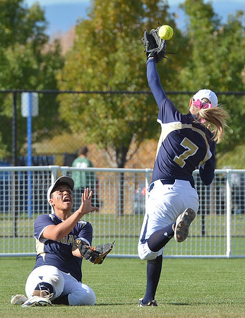 Legacy's Bekka Prokski (7) and Jocilynn Howard scramble and catch a ball hit by Fountain-Ft. Carson during Friday's state softball championships at Aurora Sports Park.<br /> <br /> October 19, 2012<br /> staff photo/ David R. Jennings
