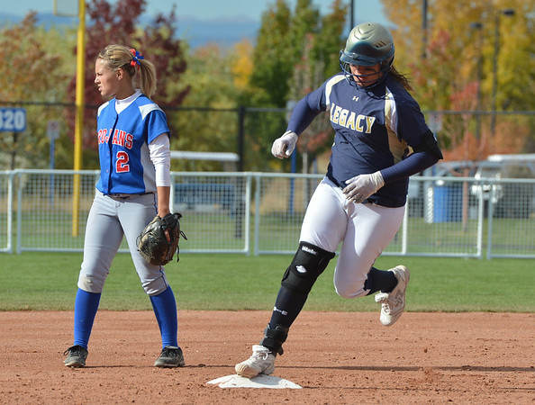 Legacy's Haley Smith rounds second base after hitting a home run against Fountain Ft. Carson during Friday's state softball championships at Aurora Sports Park.<br /> <br /> October 19, 2012<br /> staff photo/ David R. Jennings