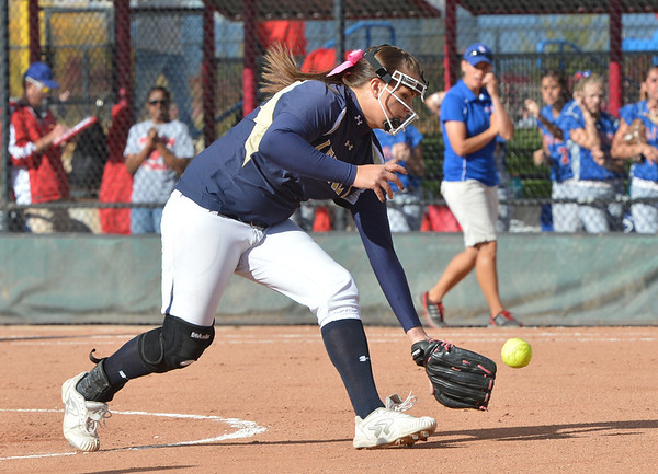 Legacy's Haley Smith scoops up an in field hit by Fountain-Ft. Carson during Friday's state softball championships at Aurora Sports Park.<br /> <br /> October 19, 2012<br /> staff photo/ David R. Jennings