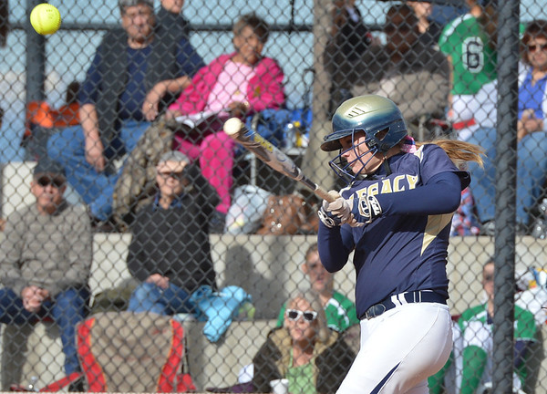 Legacy's Haley Smith hits a home run against Fountain-Ft. Carson during Friday's state softball championships at Aurora Sports Park.<br /> <br /> October 19, 2012<br /> staff photo/ David R. Jennings