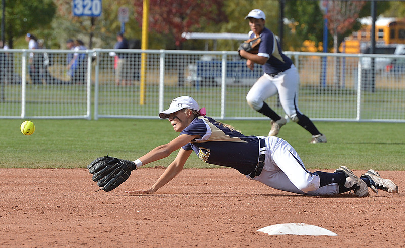 Legacy's Bekka Prokaski dives for the ball hit by Fountain-Ft. Carson during Friday's state softball championships at Aurora Sports Park.<br /> <br /> October 19, 2012<br /> staff photo/ David R. Jennings