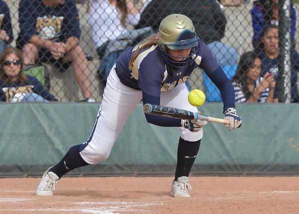 Legacy's Kylie Barnard bunts the ball against Eaglecrest during Friday's state softball championships at Aurora Sports Park.<br /> <br /> October 19, 2012<br /> staff photo/ David R. Jennings
