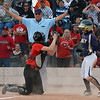 Legacy's Paige Reichmuth is ruled safe to win the game against Eaglecrest during Friday's state softball championships at Aurora Sports Park.<br /> <br /> October 19, 2012<br /> staff photo/ David R. Jennings