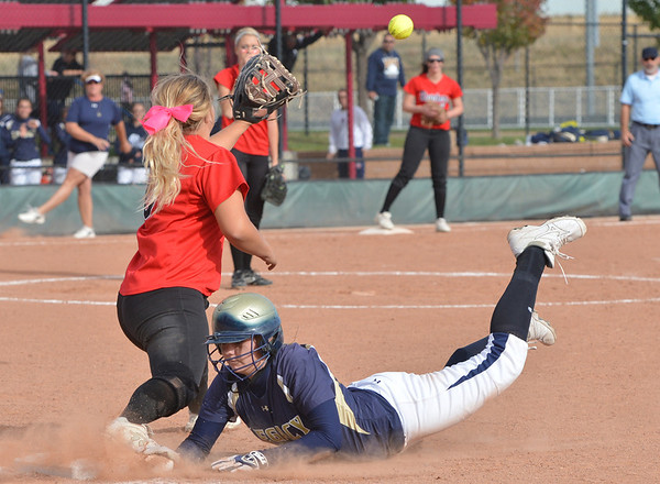 Legacy's Kylie Barnard slides safely back to first base past Eaglecrest's Taylor Kigerl-Hill during Friday's state softball championships at Aurora Sports Park.<br /> <br /> October 19, 2012<br /> staff photo/ David R. Jennings