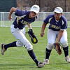 Legacy's Bekka Prokaski, left, and Jocilynn Howard catch a hit by Eaglecrest during Friday's state softball championships at Aurora Sports Park.<br /> <br /> October 19, 2012<br /> staff photo/ David R. Jennings