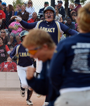 Legacy's Haley Smith celebrates after the team narrowly  defeated Eaglecrest 5-4 with the last hit of the game  during Friday's state softball championships at Aurora Sports Park.<br /> <br /> October 19, 2012<br /> staff photo/ David R. Jennings
