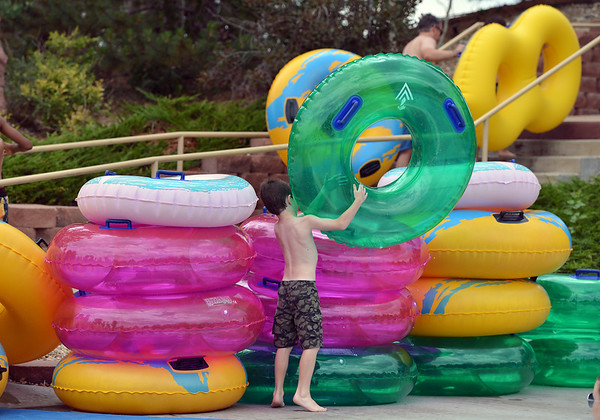 "People grab tubes to go down the big blue slide while enjoying the fun and sun at The Bay Aquatic Center on Saturday.<br /> <br /> June 30, 2012<br /> staff photo/ David R. Jennings<br /> <br /> for more photos please go to  <a href=""http://www.broomfieldenterprise.com"">http://www.broomfieldenterprise.com</a>"