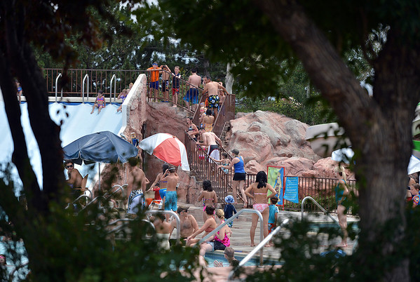 "Children and adults line up to go down a water slide at The Bay Aquatic Center on Saturday.<br /> <br /> June 30, 2012<br /> staff photo/ David R. Jennings<br /> <br /> for more photos please go to  <a href=""http://www.broomfieldenterprise.com"">http://www.broomfieldenterprise.com</a>"