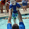 "Aris Legorreta tosses his son Alexander, 3, up in the air while playing in the pool at The Bay Aquatic Center on Saturday.<br /> <br /> <br /> June 30, 2012<br /> staff photo/ David R. Jennings<br /> <br /> for more photos please go to  <a href=""http://www.broomfieldenterprise.com"">http://www.broomfieldenterprise.com</a>"