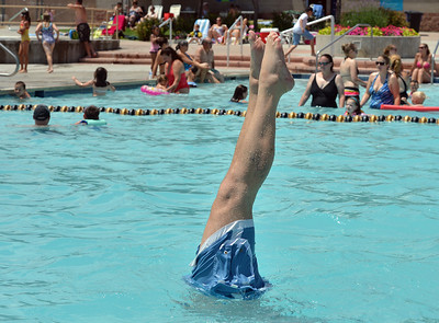 Steve Kovinchick does a hand stand in the water while enjoying the fun at The Bay Aquatic Center on Saturday.  June 30, 2012 staff photo/ David R. Jennings  for more photos please go to www.broomfieldenterprise.com