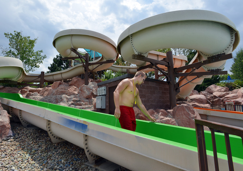 "Life Guard Kyle Day inspects the water slides during a routine afternoon break at The Bay Aquatic Center on Saturday.<br /> <br /> <br /> June 30, 2012<br /> staff photo/ David R. Jennings<br /> <br /> for more photos please go to  <a href=""http://www.broomfieldenterprise.com"">http://www.broomfieldenterprise.com</a>"