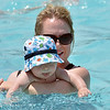 "Wendy Legorreta plays with her son Maximillian, 10 months-old, in the pool at The Bay Aquatic Center on Saturday.<br /> <br /> June 30, 2012<br /> staff photo/ David R. Jennings<br /> <br /> for more photos please go to  <a href=""http://www.broomfieldenterprise.com"">http://www.broomfieldenterprise.com</a>"