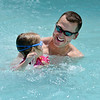 "Mike Ramey and his daughter Payton, 3, move to the edge of the pool after going down the water slides at The Bay Aquatic Center on Saturday.<br /> <br /> June 30, 2012<br /> staff photo/ David R. Jennings<br /> <br /> for more photos please go to  <a href=""http://www.broomfieldenterprise.com"">http://www.broomfieldenterprise.com</a>"