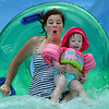 "Kerry Carter and her daughter Catherine, 1 1/2, splash in the pool of the big blue slide while enjoying the fun and cooling off at The Bay Aquatic Center on Saturday.<br /> <br /> June 30, 2012<br /> staff photo/ David R. Jennings<br /> <br /> for more photos and video please go to  <a href=""http://www.broomfieldenterprise.com"">http://www.broomfieldenterprise.com</a>"