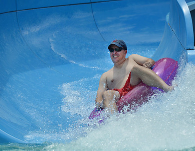 Scott Stenger goes down the big blue water slide while enjoying the fun at The Bay Aquatic Center on Saturday.  June 30, 2012 staff photo/ David R. Jennings  for more photos please go to www.broomfieldenterprise.com