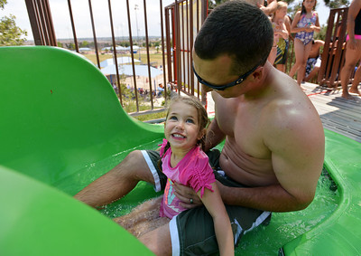 Payton Ramey, 3, looks at her father Mike as they get ready to go down the green slide while enjoying the fun at The Bay Aquatic Center on Saturday.  June 30, 2012 staff photo/ David R. Jennings  for more photos please go to www.broomfieldenterprise.com