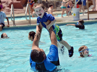 Aris Legorreta tosses his son Alexander, 3, up in the air while playing in the pool at The Bay Aquatic Center on Saturday.  June 30, 2012 staff photo/ David R. Jennings  for more photos please go to www.broomfieldenterprise.com