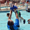 "Aris Legorreta tosses his son Alexander, 3, up in the air while playing in the pool at The Bay Aquatic Center on Saturday.<br /> <br /> June 30, 2012<br /> staff photo/ David R. Jennings<br /> <br /> for more photos please go to  <a href=""http://www.broomfieldenterprise.com"">http://www.broomfieldenterprise.com</a>"