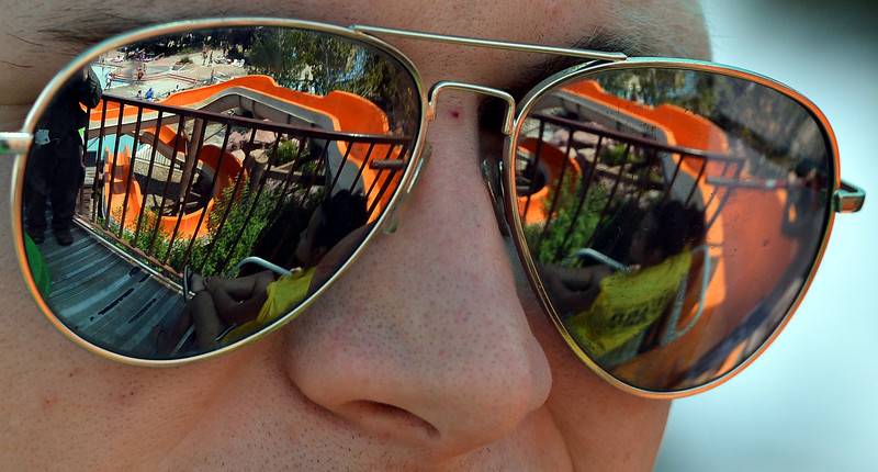 "The Bay Aquatic Center is reflected on the sunglasses of life guard Kyle Day on Saturday.<br /> <br /> June 30, 2012<br /> staff photo/ David R. Jennings<br /> <br /> for more photos please go to  <a href=""http://www.broomfieldenterprise.com"">http://www.broomfieldenterprise.com</a>"