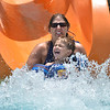 "Allison Patrick and her son Cater, 4, make a big splash after going down the orange slide while cooling off from the heat and enjoying the fun at The Bay Aquatic Center on Saturday.<br /> <br /> June 30, 2012<br /> staff photo/ David R. Jennings<br /> <br /> for more photos please go to  <a href=""http://www.broomfieldenterprise.com"">http://www.broomfieldenterprise.com</a>"