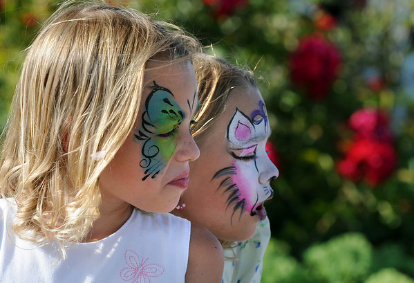 Twin sisters Cali and  Ella Schigur, 8, had their faces painted during Sunday's Summer Sundays Finale Carnival and Concert for the Broomfield Council on the Arts and Humanities at the Brunner House.<br /> <br /> August 9, 2009<br /> staff photo/David R. Jennings