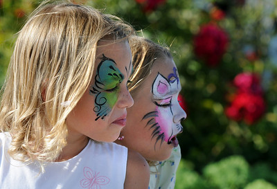 Twin sisters Cali and  Ella Schigur, 8, had their faces painted during Sunday's Summer Sundays Finale Carnival and Concert for the Broomfield Council on the Arts and Humanities at the Brunner House.  August 9, 2009 staff photo/David R. Jennings