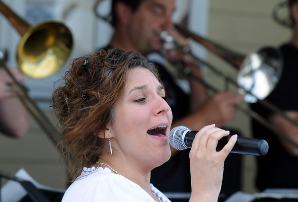 Vocalist Suzanne Morrison sings with the Metropolitan Jazz Orchestra during Sunday's Summer Sundays Finale Carnival and Concert for the Broomfield Council on the Arts and Humanities at the Brunner House.<br /> <br /> August 9, 2009<br /> staff photo/David R. Jennings