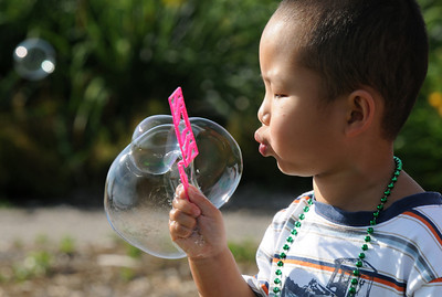 Oscar Zheng, 4, blows bubbles  during Sunday's Summer Sundays Finale Carnival and Concert for the Broomfield Council on the Arts and Humanities at the Brunner House.  August 9, 2009 staff photo/David R. Jennings