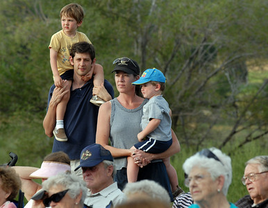 The Spivak family, Todd, left, holding Cy, 3 1/2 on his shoulders and Melissa holding Ethan, 2, listen to the music of the Metropolitan Jazz Orchestra during Sunday's Summer Sundays Finale Carnival and Concert for the Broomfield Council on the Arts and Humanities at the Brunner House.  August 9, 2009 staff photo/David R. Jennings