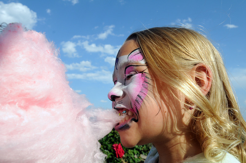 Ella Schigur, 8, eats cotton candy during Sunday's Summer Sundays Finale Carnival and Concert for the Broomfield Council on the Arts and Humanities at the Brunner House.<br /> <br /> August 9, 2009<br /> staff photo/David R. Jennings
