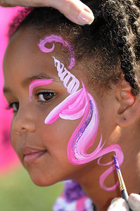 Kimberly Dorian, 4, had a unicorn painted on her face during Sunday's Summer Sundays Finale Carnival and Concert for the Broomfield Council on the Arts and Humanities at the Brunner House.  August 9, 2009 staff photo/David R. Jennings
