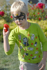 Ben Sandoz, 5, throws a bag for a tick-tack toe game during Sunday's Summer Sundays Finale Carnival and Concert for the Broomfield Council on the Arts and Humanities at the Brunner House.  August 9, 2009 staff photo/David R. Jennings