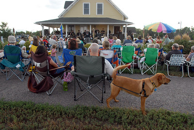 Evening concert goers listen to the music of the Metroplolitan Jazz Orchestra during Sunday's Summer Sundays Finale Carnival and Concert for the Broomfield Council on the Arts and Humanities at the Brunner House.  August 9, 2009 staff photo/David R. Jennings
