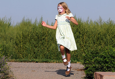 Ella Schigur, 8, skips around the garden area waiting for the concert to begin during Sunday's Summer Sundays Finale Carnival and Concert for the Broomfield Council on the Arts and Humanities at the Brunner House.  August 9, 2009 staff photo/David R. Jennings