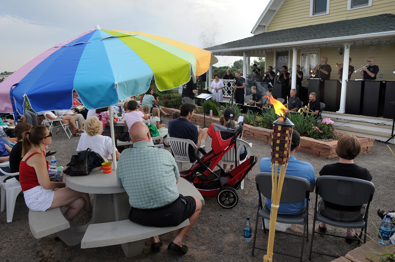 People sit back to enjoy the concert by the Metropolitan Jazz Orchestra during Sunday's Summer Sundays Finale Carnival and Concert for the Broomfield Council on the Arts and Humanities at the Brunner House.<br /> <br /> August 9, 2009<br /> staff photo/David R. Jennings