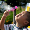 Oscar Zheng, 4, blows bubbles  during Sunday's Summer Sundays Finale Carnival and Concert for the Broomfield Council on the Arts and Humanities at the Brunner House.<br /> <br /> August 9, 2009<br /> staff photo/David R. Jennings