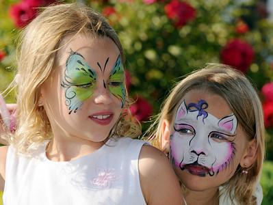 Twin sisters Cali and  Ella Schigur, 8, watch the face painting  during Sunday's Summer Sundays Finale Carnival and Concert for the Broomfield Council on the Arts and Humanities at the Brunner House.  August 9, 2009 staff photo/David R. Jennings