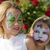 Twin sisters Cali and  Ella Schigur, 8, watch the face painting  during Sunday's Summer Sundays Finale Carnival and Concert for the Broomfield Council on the Arts and Humanities at the Brunner House.<br /> <br /> August 9, 2009<br /> staff photo/David R. Jennings