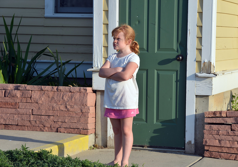 Julia Wood, 8, stands by the side of the house listening to the music by the Carbone Family Band for Summer Sundays at the Historic Brunner Farmhouse on Sunday<br /> June 9, 2012 <br /> staff photo/ David R. Jennings