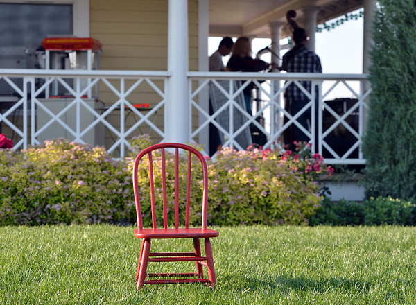 A red chair sits on the lawn during the concert by the Carbone Family Band for Summer Sundays at the Historic Brunner Farmhouse on Sunday<br /> June 9, 2012 <br /> staff photo/ David R. Jennings