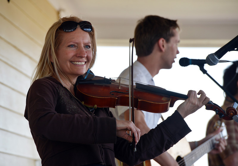 Marianne Gibbs plays the fiddle for the Carbone Family Band during Summer Sundays at the Historic Brunner Farmhouse on Sunday<br /> June 9, 2012 <br /> staff photo/ David R. Jennings