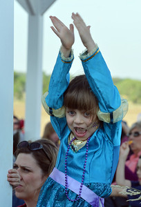Claire Dokter, 6, applauds during the concert by the Carbone Family Band for Summer Sundays at the Historic Brunner Farmhouse on Sunday June 9, 2012  staff photo/ David R. Jennings