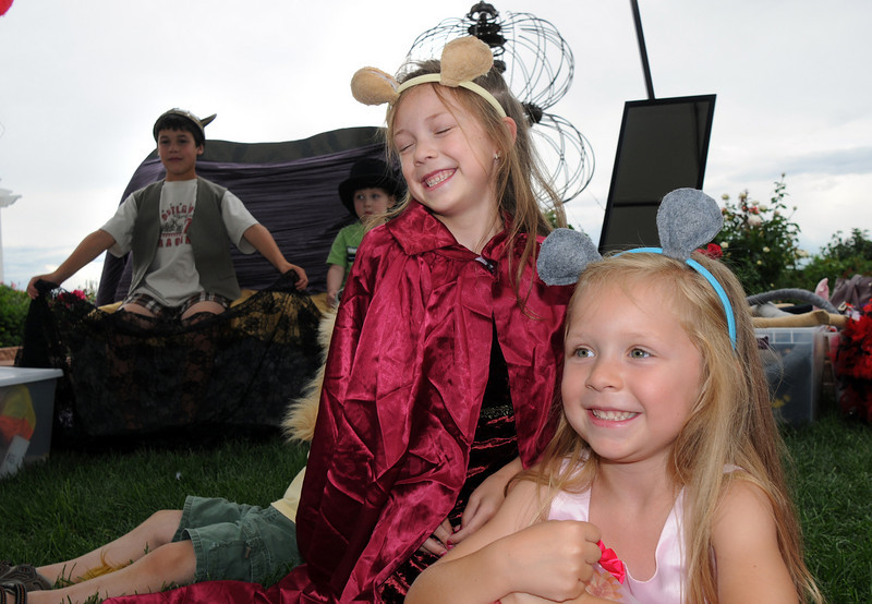 Sisters Gracie Nordgren, 8, left and Ava, 5, play their parts as mice in an improvisational play of the lion and the mouse at the Backstory Theater booth during the Broomfield Council on the Arts and Humanities Summer Sundays at the Brunner <br /> Farmhouse. Sunday was Ava Nordgren's birthday.<br /> <br /> July 11, 2010<br /> Staff photo/ David R. Jennings