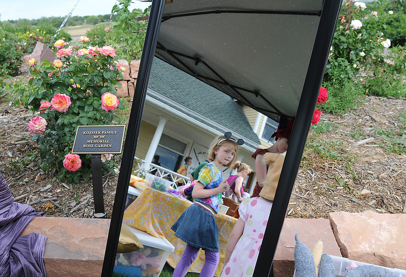 Julia Kirk, 7, wearing mouse ears, is reflected in a mirror at the Backstory Theater booth  during the Broomfield Council on the Arts and Humanities Summer Sundays at the Brunner <br /> Farmhouse.<br /> <br /> July 11, 2010<br /> Staff photo/ David R. Jennings
