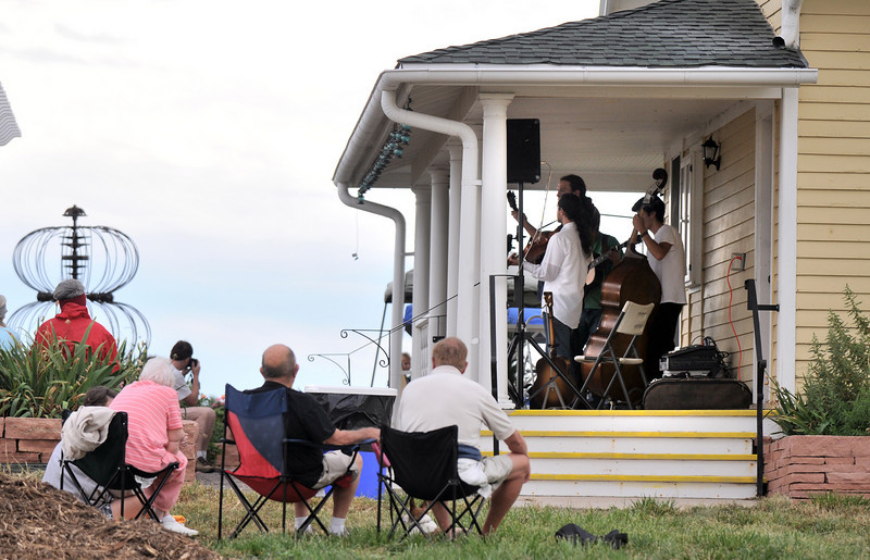 People relax to the evening bluegrass music by Martin Gilmore and Long Road Home during the Broomfield Council on the Arts and Humanities Summer Sundays at the Brunner <br /> Farmhouse.<br /> <br /> July 11, 2010<br /> Staff photo/ David R. Jennings