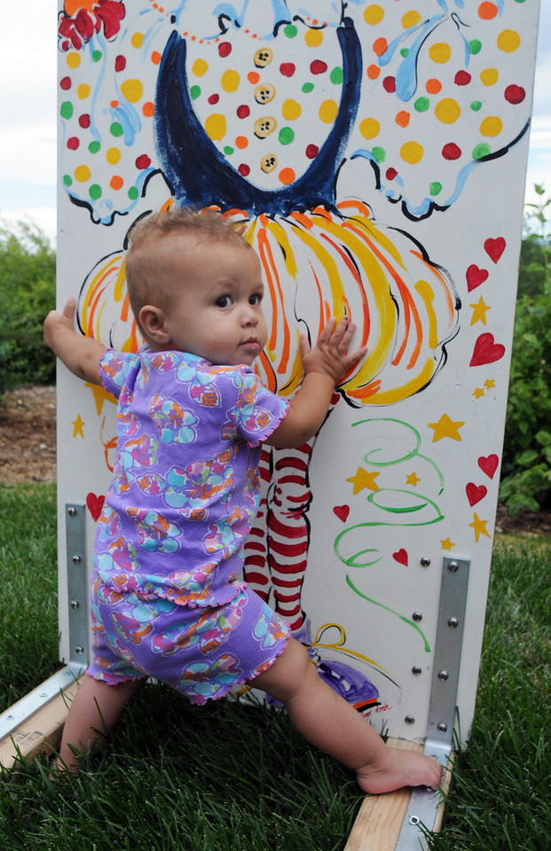 Brielle Ryan, 1, leans on a prop during the Broomfield Council on the Arts and Humanities Summer Sundays at the Brunner <br /> Farmhouse.<br /> <br /> July 11, 2010<br /> Staff photo/ David R. Jennings