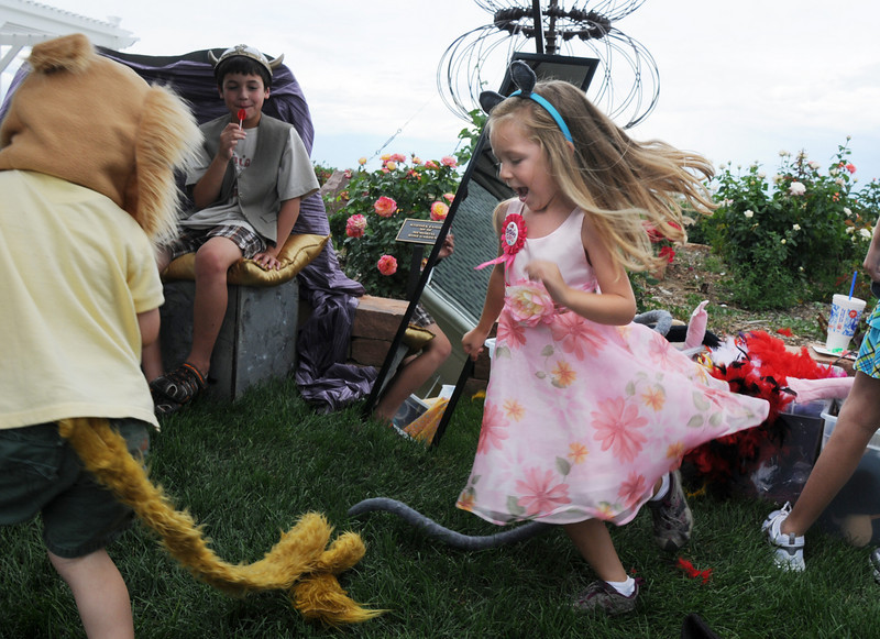 Ava Nordgren, 5, chases Cole Bialek, 3, a lion in an improvisational play with the Backstory Theater booth during the Broomfield Council on the Arts and Humanities Summer Sundays at the Brunner <br /> Farmhouse.<br /> <br /> July 11, 2010<br /> Staff photo/ David R. Jennings