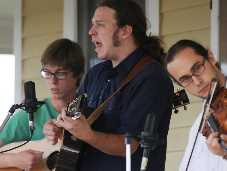 Martin Gilmore, center, with his  band members Patrick Detalefs, left, and Justin Hoffenberg play bluegrass music during the Broomfield Council on the Arts and Humanities Summer Sundays at the Brunner <br /> Farmhouse.<br /> <br /> July 11, 2010<br /> Staff photo/ David R. Jennings
