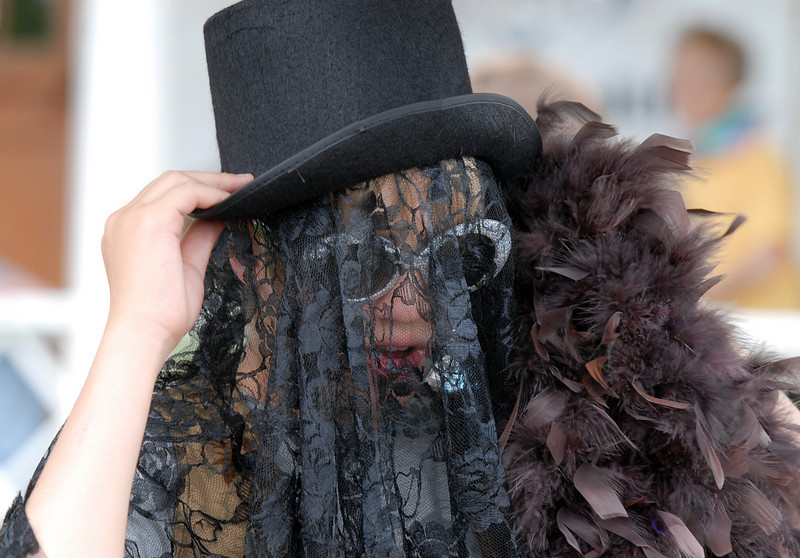 Connor Hollis, 12, works on his costume as a raven during the Broomfield Council on the Arts and Humanities Summer Sundays at the Brunner <br /> Farmhouse.<br /> <br /> July 11, 2010<br /> Staff photo/ David R. Jennings