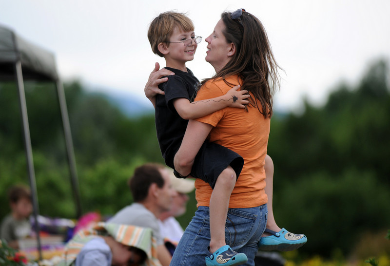 Karen Funk dances with her son Evan Dilts, 5, while listening to the music of Martin Gilmore and Long Road Home bluegrass band during the Broomfield Council on the Arts and Humanities Summer Sundays at the Brunner <br /> Farmhouse.<br /> <br /> July 11, 2010<br /> Staff photo/ David R. Jennings